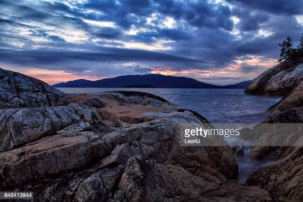 lighthouse park sunset in summer, west vancouver, bc, canada - coastline stock pictures, royalty-free photos & images