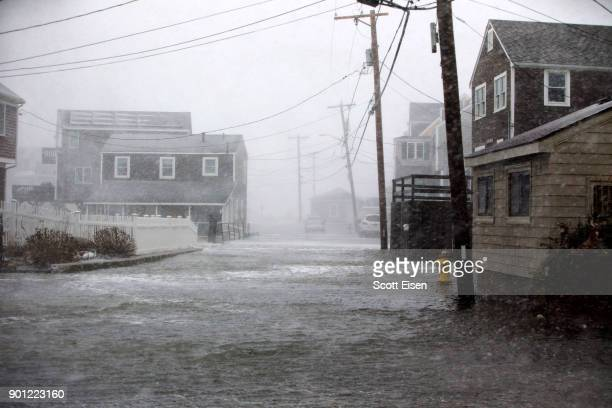 Lighthouse Rd begins to flood as a massive winter storm begins to bear down on the region on January 4 2018 in Scituate Massachusetts The bomb...