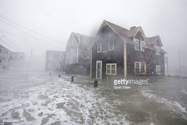 Lighthouse Rd begins to flood to during a large coastal storm on March 2 2018 in Scituate Massachusetts A nor'easter is set to slam the East Coast on...