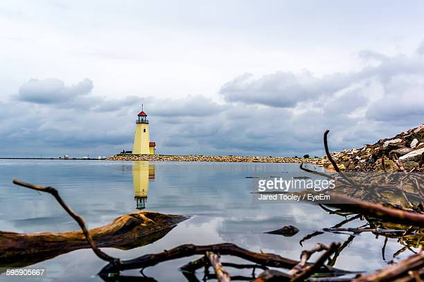 lighthouse reflecting on lake hefner against cloudy sky - oklahoma city stock pictures, royalty-free photos & images