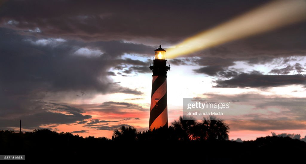 Lighthouse Search Beam At Sunset : Stock Photo