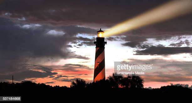 Lighthouse Search Beam At Sunset