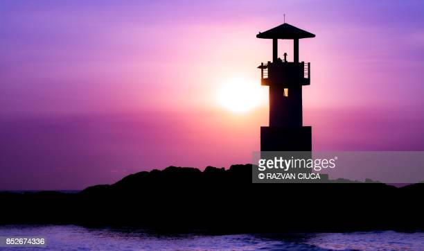 lighthouse silhouette - rocky coastline stock pictures, royalty-free photos & images