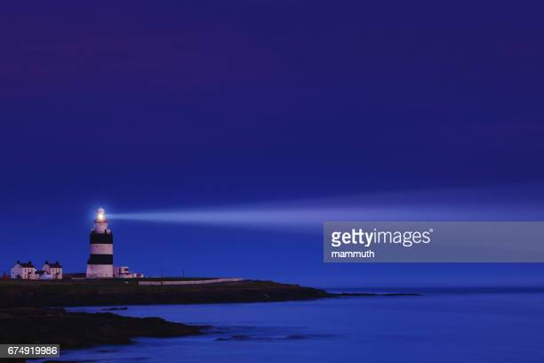 lighthouse the night - hook head in county wexford, ireland - lighthouse stock pictures, royalty-free photos & images