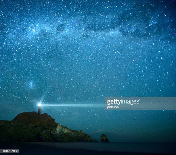 lighthouse under milky way stars - hope stock pictures, royalty-free photos & images