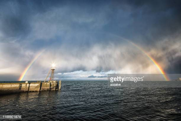 lighthouse warning from incoming storm on lake constance - pareidolia stock pictures, royalty-free photos & images