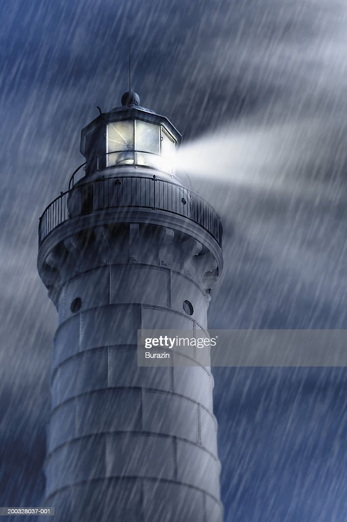 Lighthouse With Beacon Shining In Storm Night Low Angle View