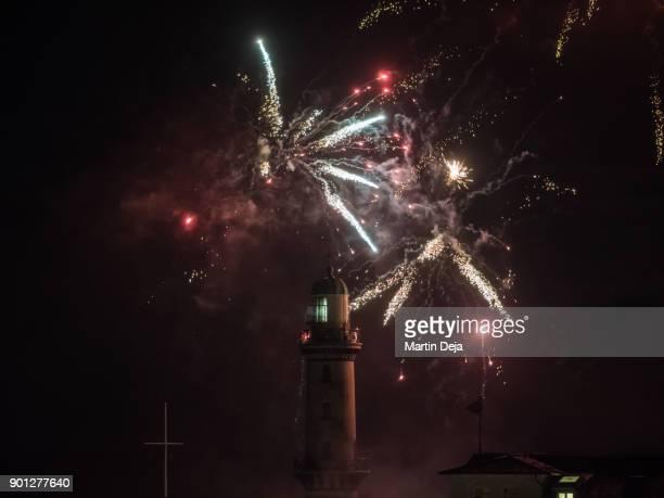 lighthouse with fireworks - rostock - fotografias e filmes do acervo