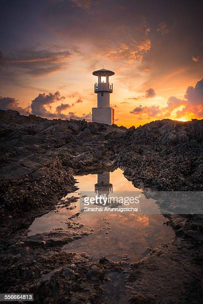 Lighthouse with reflection at sunset