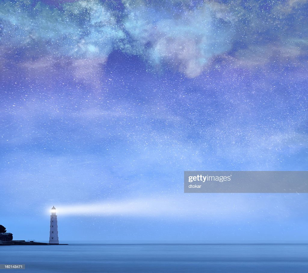 Lighthouse with stars at night : Stock Photo