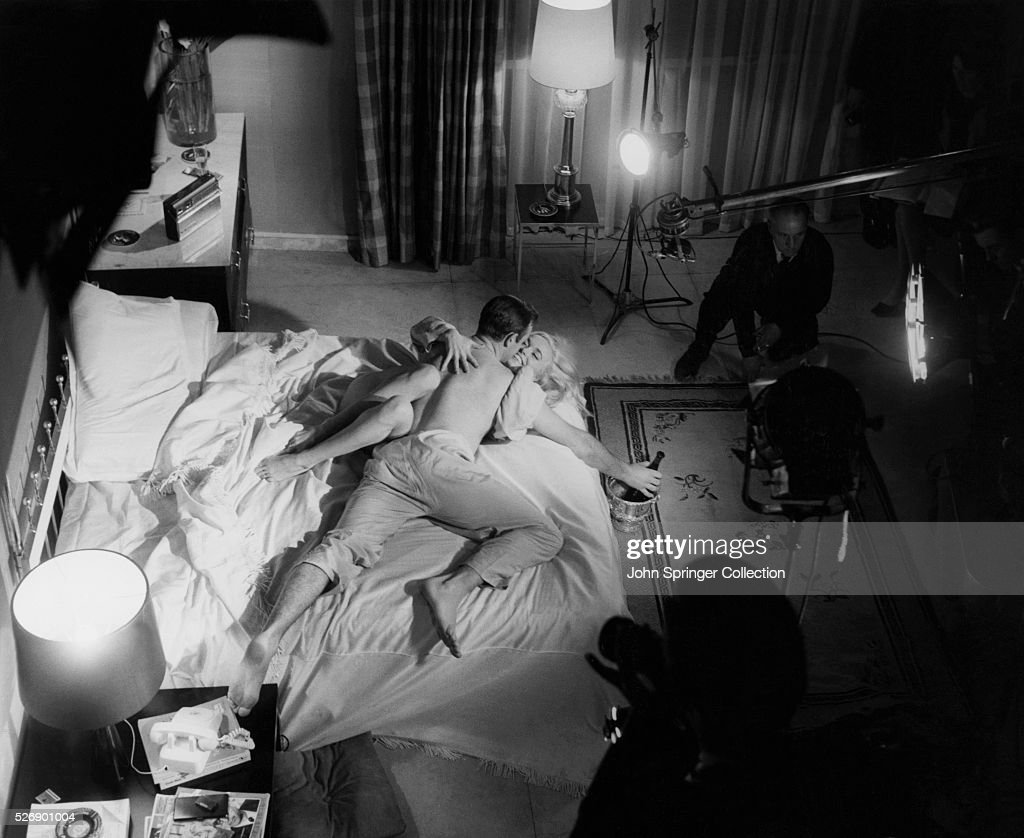 Lighting and film crew working with Sean Connery and Shirley Eaton in a bedroom scene of & Sean Connery and Shirley Eaton Filming a Love Scene in Goldfinger ... azcodes.com