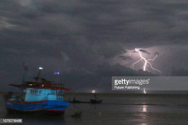 Lighting bolts striking around Mount Anak Krakatau are seen from Carita beach on December 24 in Tanjung Lesung Banten Indonesia The data collected by...