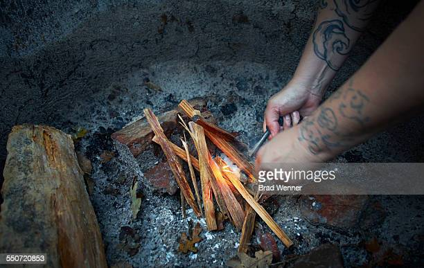 lighting campfire with flint and steel - flint tool stock photos and pictures