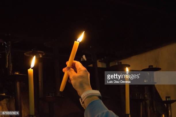 lighting candles in memory of the dead - religious vigil stock photos and pictures