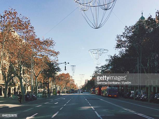 Lighting Decorations Hanging Over Street Against Clear Sky