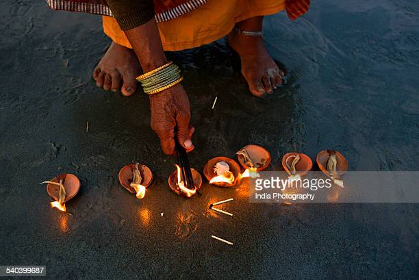 Lighting Diyas at Gangasagar Fair