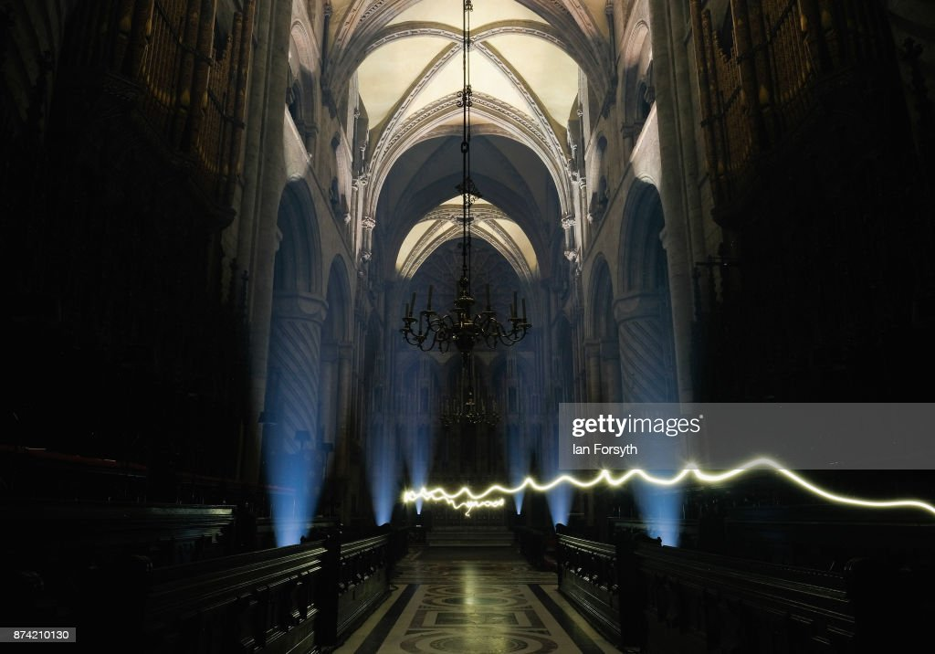 A lighting engineer wearing a head torch walks through the picture as the inside of the historic Durham Cathedral is illuminated by a light installation titled 'Methods' by artist Pablo Valbuena during a media preview evening ahead of the Durham Lumiere event on November 14, 2017 in Durham, England. The installation was inspired by the tradition of English change ringing. The Lumiere light festival is the UK's largest light festival and comes to the City of Durham for the fifth time bringing large scale projections and light installations across the city to landmark locations.