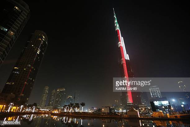 Lighting illuminates the Burj Khalifa tower in the colours of the Emirati flag early on January 1 2015 in downtown Dubai during New Year celebrations...