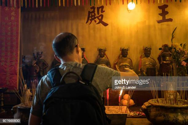 Lighting Joss Sticks at Man Mo Temple Hong Kong Man Mo Temple or Man Mo Miu is a temple in Hong Kong that reveres both the God of Literature and the...