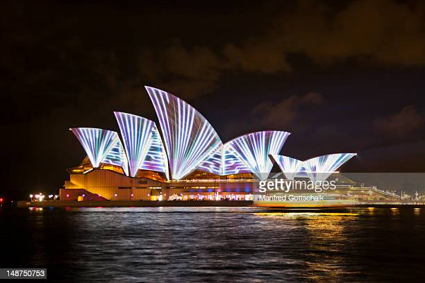 Lighting of the sails of the Sydney Opera House during the Vivid Live 2011 Festival with lighting effects by the French Collective Superbien.