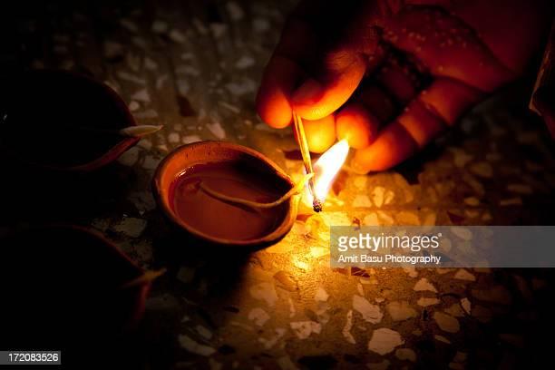 lighting oil lamps (diya / pradeep) for diwali - amit basu stock pictures, royalty-free photos & images