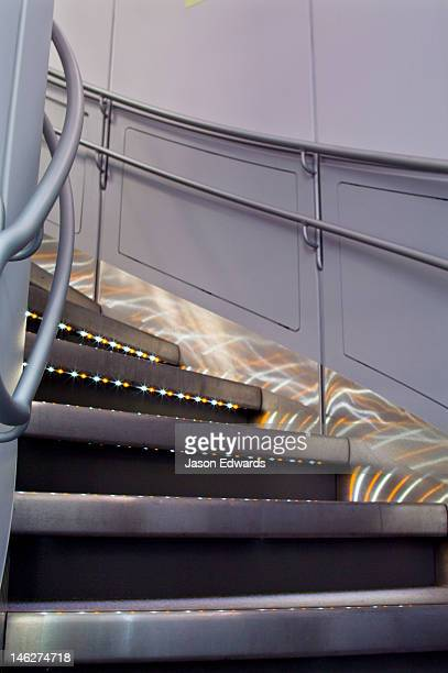 LED lighting on stainless steel steps leading to business class.