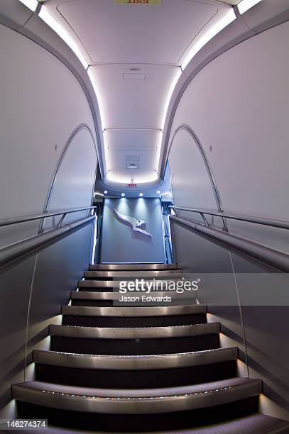 LED lighting on stainless steel steps leads to the first class cabin.