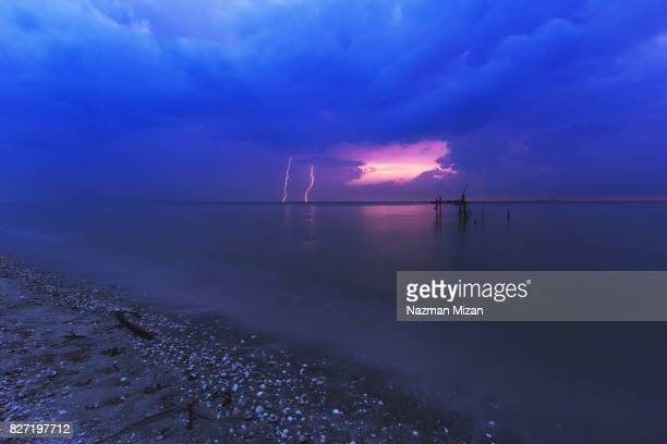 A lighting strike was captured at a beach.