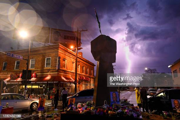 Lighting strikes near the intersection of Chicago Avenue and 38th Street, also know as George Floyd Square on April 6, 2021 in Minneapolis,...