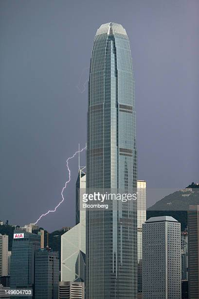 Lighting strikes near Two International Finance Center center as it stands in the central business district of Hong Kong China on Saturday July 21...
