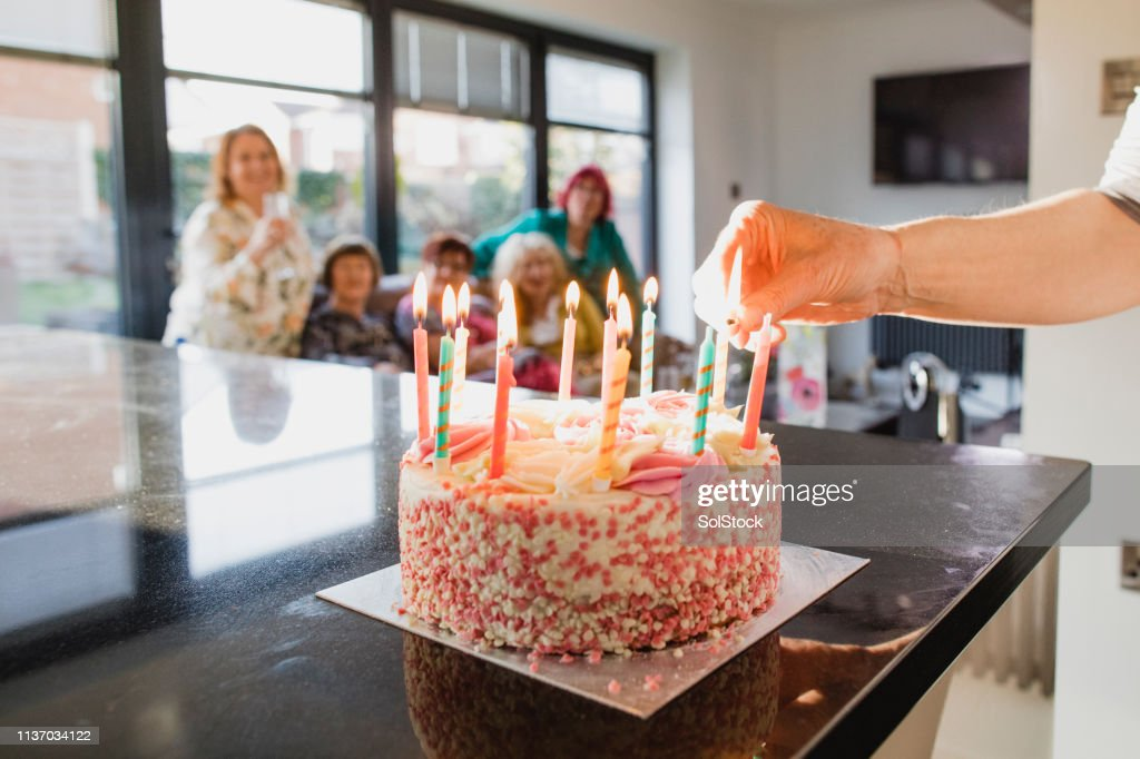 Lighting the Candles on the Cake : Stock Photo
