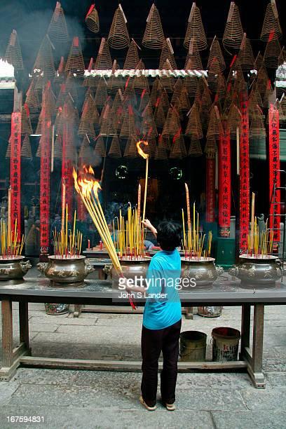 Lighting up giant sticks of incense at Thien Hau Pagoda in Saigon