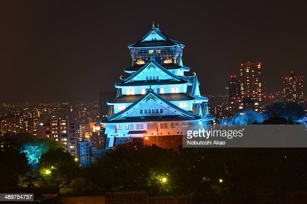 Lighting-up of Osaka Castle at night during the cherry blossom season.