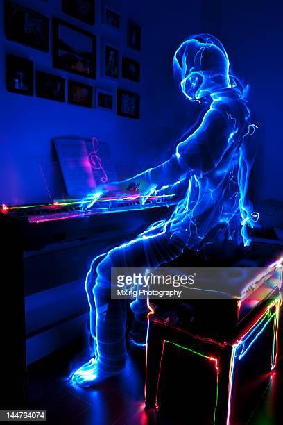 Lightman playing piano
