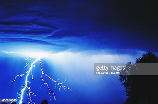 Lightning Against Cloudy Sky At Night