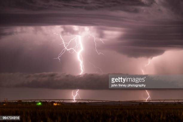 lightning and storm cloud structure, nebraska. usa - extreme weather stock photos and pictures