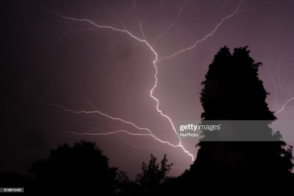 Lightning And Thunder Fill The Night Air As A Lighting Storm Passes Over  Surrey In Southern