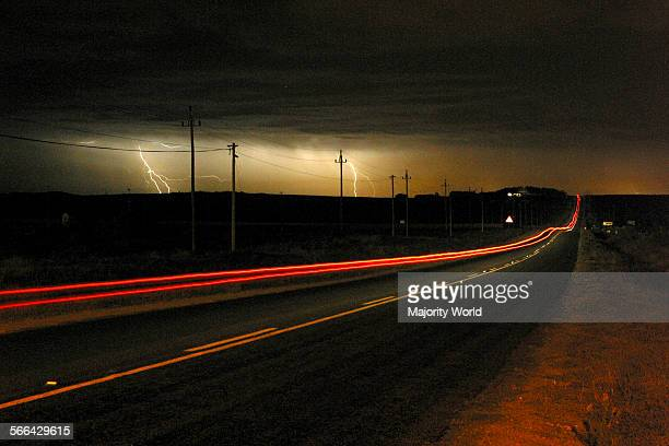 lightning and traffic trails of car lights shot with a slow shutter speed West Coast South Africa