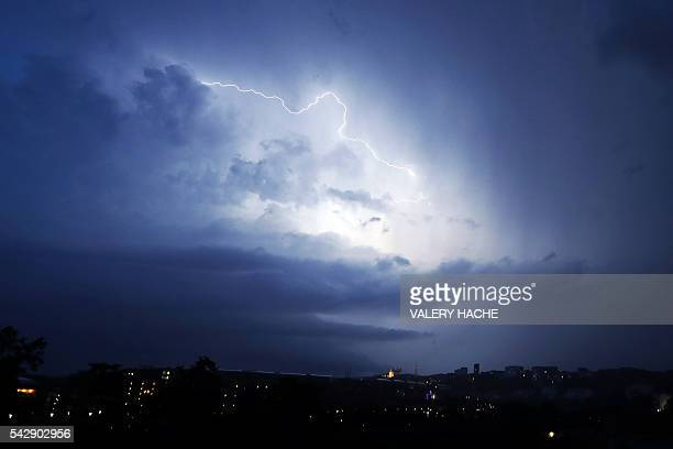 A lightning blusters the sky of Lyon on the evening of June 24 in Lyon / AFP / VALERY HACHE