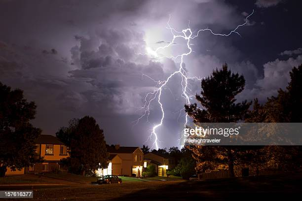 lightning bolt and thunderhead storms over denver neighborhood homes - storm stock pictures, royalty-free photos & images