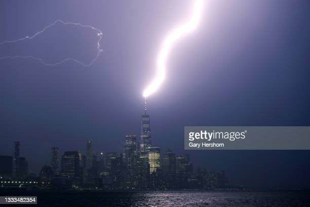 Lightning bolt strikes One World Trade Center as a thunderstorm passes through lower Manhattan in New York City on August 10, 2021 as seen from...