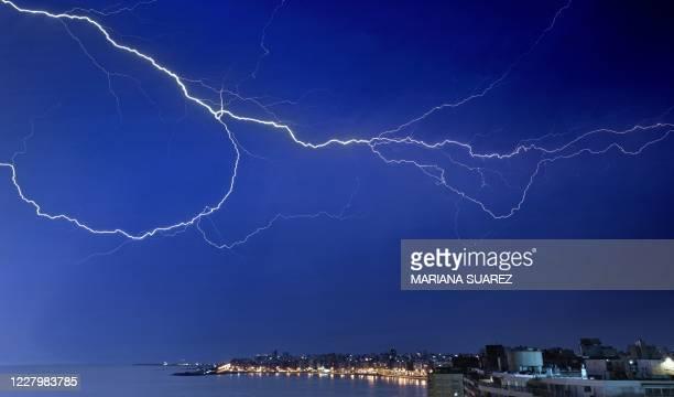 Lightning bolt strikes over Montevideo's Pocitos neighbourhood early on August 10, 2020.