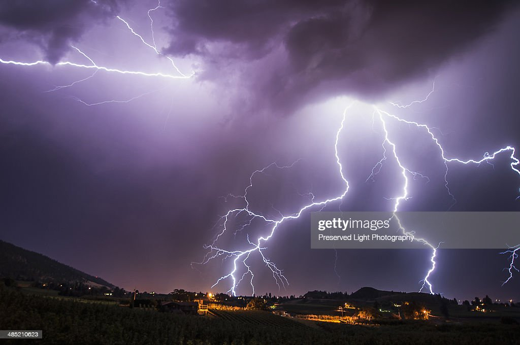 Lightning bolts over south Okanagan Valley, Penticton, British Columbia, Canada : Stock Photo