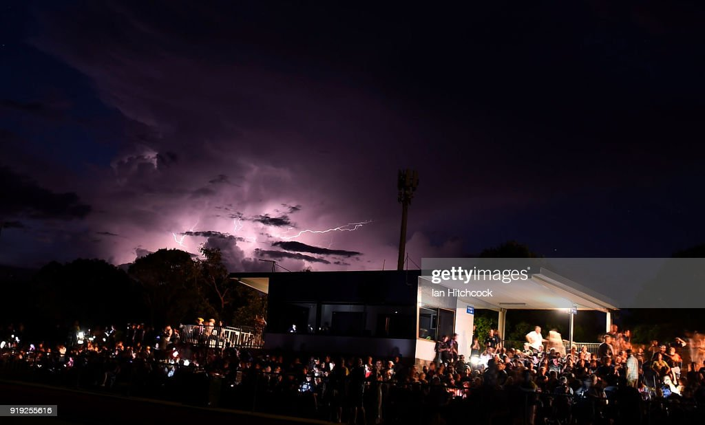 Lightning breaks in the sky whilst there is a power outage at the ground before the start of the NRL trial match between the North Queensland Cowboys and the Wests Tigers at Barlow Park on February 17, 2018 in Cairns, Australia.