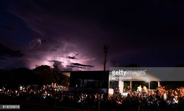 Lightning breaks in the sky whilst there is a power outage at the ground before the start of the NRL trial match between the North Queensland Cowboys...