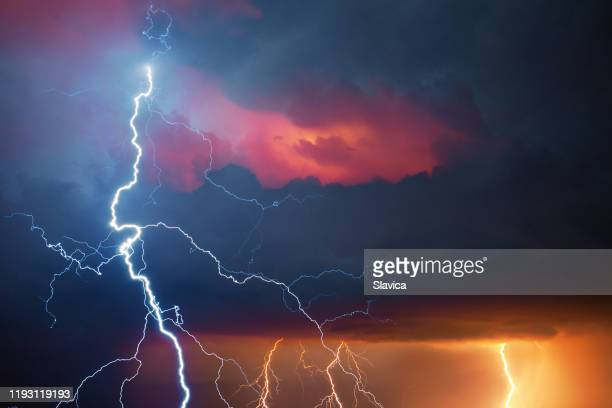 lightning during summer storm - extreme weather stock pictures, royalty-free photos & images