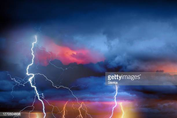 lightning during summer storm - lightning stock pictures, royalty-free photos & images