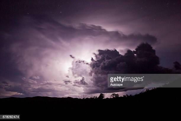 Lightning flash behind a cloud at night Flinders Ranges South Australia Australia