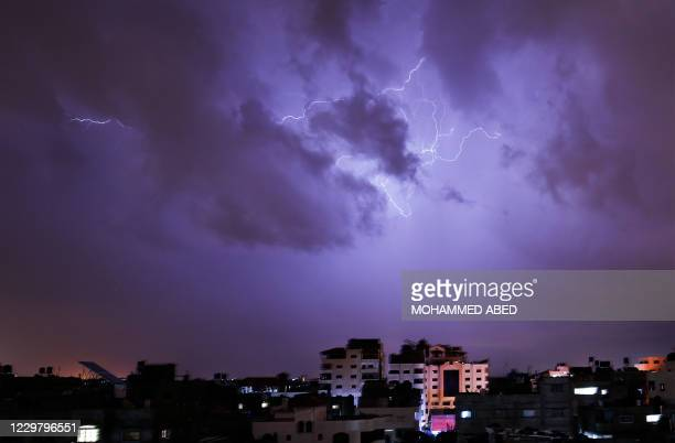 Lightning flash over buildings during a thunderstorm in Gaza city on November 26 2020