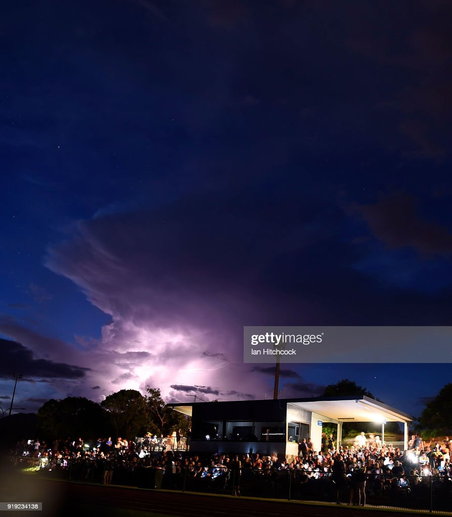 Lightning flashes are seen during a power outage before the start of the NRL trial match between the North Queensland Cowboys and the Wests Tigers at Barlow Park on February 17, 2018 in Cairns, Australia.